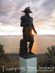 Sunset at Poverty Bay looking towards Young Nicks Head, Captain Cook statue in foreground